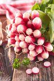 Fresh radish. On wood background Stock Photography