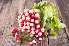 Fresh radish on wood. Background Royalty Free Stock Photography