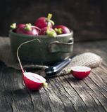 Fresh radish on wooden board. On wooden background Stock Photography