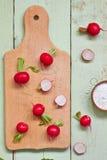 Fresh radish. On wooden cutting board Stock Image