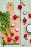 Fresh radish. On wooden cutting board Royalty Free Stock Photo