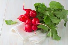Fresh radish. On wooden table Royalty Free Stock Image