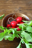 Fresh radishes in a bowl Stock Photo