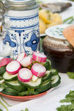 Fresh radishes and cucumbers sliced. On the festive table Stock Images