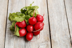 Fresh radishes from ground on old wooden table. Healthy food Royalty Free Stock Photo