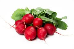 Fresh radishes isolated on white. Bunch of fresh radishes isolated on white Stock Photo