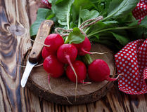 Fresh radishes and knife. Selective focus Royalty Free Stock Photos