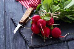 Fresh radishes and knife. Selective focus Stock Image