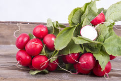 Fresh radishes on old wooden boards Royalty Free Stock Photography