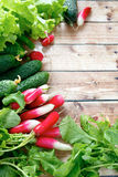 Fresh radishes and other vegetables on wooden boards. Top view Stock Photography