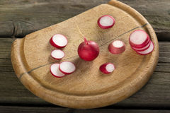 Fresh radishes slices. On a wooden cutting board Stock Photography