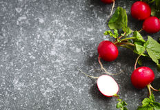 Fresh radishes on stone background. With copy space Stock Photo
