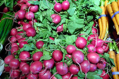 Fresh radishes at a supermarket. A close-up of radishes for sale in a grocery store Stock Photo