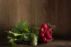 Fresh radishes on table. Fresh radishes on old wooden table with copy space Royalty Free Stock Photography