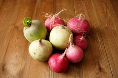 Fresh radishes. On wood background Royalty Free Stock Photo
