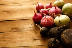 Fresh radishes. On wood table Royalty Free Stock Image