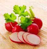 Fresh  radishes  . Fresh  radishes   on wooden background Stock Photo