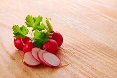 Fresh  radishes   . Fresh  radishes   on wooden background Stock Photography