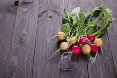 Fresh radishes. On a wooden background Stock Image