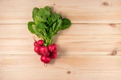 Fresh radishes on wooden background. Flat lay Royalty Free Stock Images