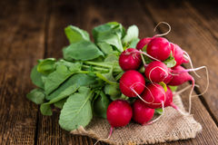 Fresh Radishes on wooden background. (selective focus; close-up shot Stock Photography
