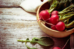Fresh radishes on wooden background. Selective focus. Space for text. Toned photo Royalty Free Stock Images