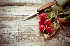 Fresh radishes on wooden background. Toned photo. Selective focus Royalty Free Stock Images