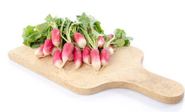 Fresh radishes on wooden board. On white Royalty Free Stock Photos