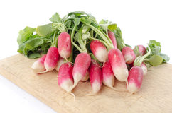Fresh radishes on wooden board. On white Royalty Free Stock Photography
