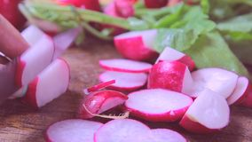 Fresh radishes on wooden table, cutting stock video