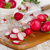 Fresh radishes on a  wooden table. Fresh radishes on  a wooden table. Selective focus Royalty Free Stock Photo