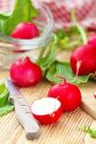 Fresh radishes on wooden table. Fresh sliced radishes on wooden table Royalty Free Stock Images
