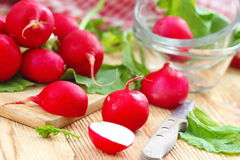 Fresh radishes on wooden table. Fresh sliced radishes on wooden table Stock Photography