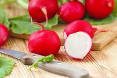 Fresh radishes on wooden table. Fresh sliced radishes on wooden table Stock Photo