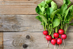 Fresh radishes on wooden table. Top view Royalty Free Stock Photos
