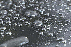 Fresh rain drop abstract in black. Background Stock Photography