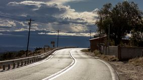 Fresh rain on hi road to Taos, New Mexico - National Scenic Byway, Truchas, New Mexico. OCTOBER 9, 2018 - Truchas, New Mexico, USA - Fresh rain on hi road to stock images