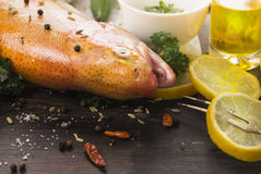 Fresh rainbow trout fish with herb spices  and oil. Fresh rainbow trout fish with herb spices on old wooden table Royalty Free Stock Images