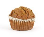 Fresh raisin bran muffin. A freshly baked raisin bran muffin on a white background Royalty Free Stock Image