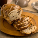 Fresh Raisin Bread. Fresh baked raisin bread sliced on cutting board and ready for eating Stock Photography