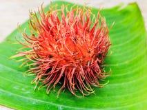 Fresh rambutan. On Babana leaf Stock Images