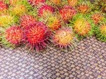 Fresh rambutan. On Bamboo tray Royalty Free Stock Photo