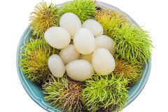 Fresh rambutan in bowl isolated on white background. Fresh and ripe rambutans in bowl isolated on white background Royalty Free Stock Image