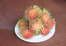 Fresh rambutan fruit in dish. Fresh rambutan fruit in dish on the foods table Royalty Free Stock Photos
