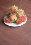 Fresh rambutan fruit in dish. Fresh rambutan fruit in dish on the foods table Stock Images