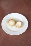 Fresh rambutan fruit of peeling in dish. Fresh rambutan fruit of peeling in dish on the foods table Royalty Free Stock Photos