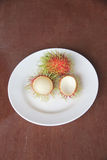 Fresh rambutan fruit of peeling in dish. Fresh rambutan fruit of peeling in dish on the foods table Stock Photography