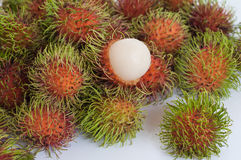 Fresh rambutan fruit. Fresh red rambutan is an exotic fruit of Southeast Asia Stock Image