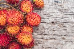 Fresh rambutan fruit on wooden teble background, closeup, fruit in Thailand.  Royalty Free Stock Photos