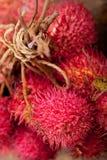 Fresh rambutan fruits. Fresh tropical rambutan fruits over rustic wood table Royalty Free Stock Photo